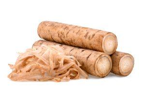 burdock roots isolated white - Жареный корень лопуха
